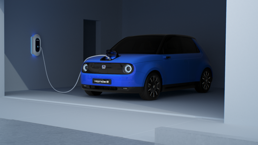 Front three-quarter view hond e charging in garage