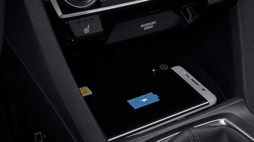 Close up shot of Honda Civic 4 door wireless phone charger.