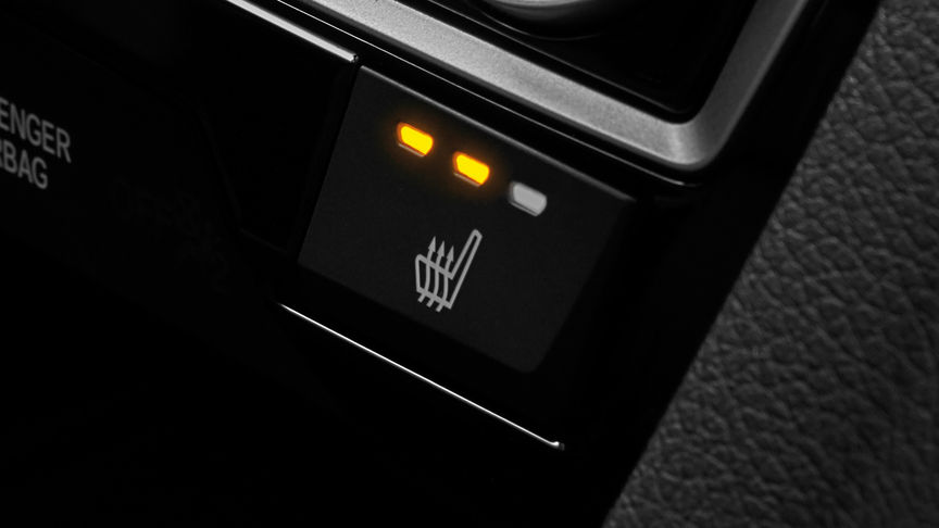 Close up shot of Honda Civic 4 door rear heated seats button.