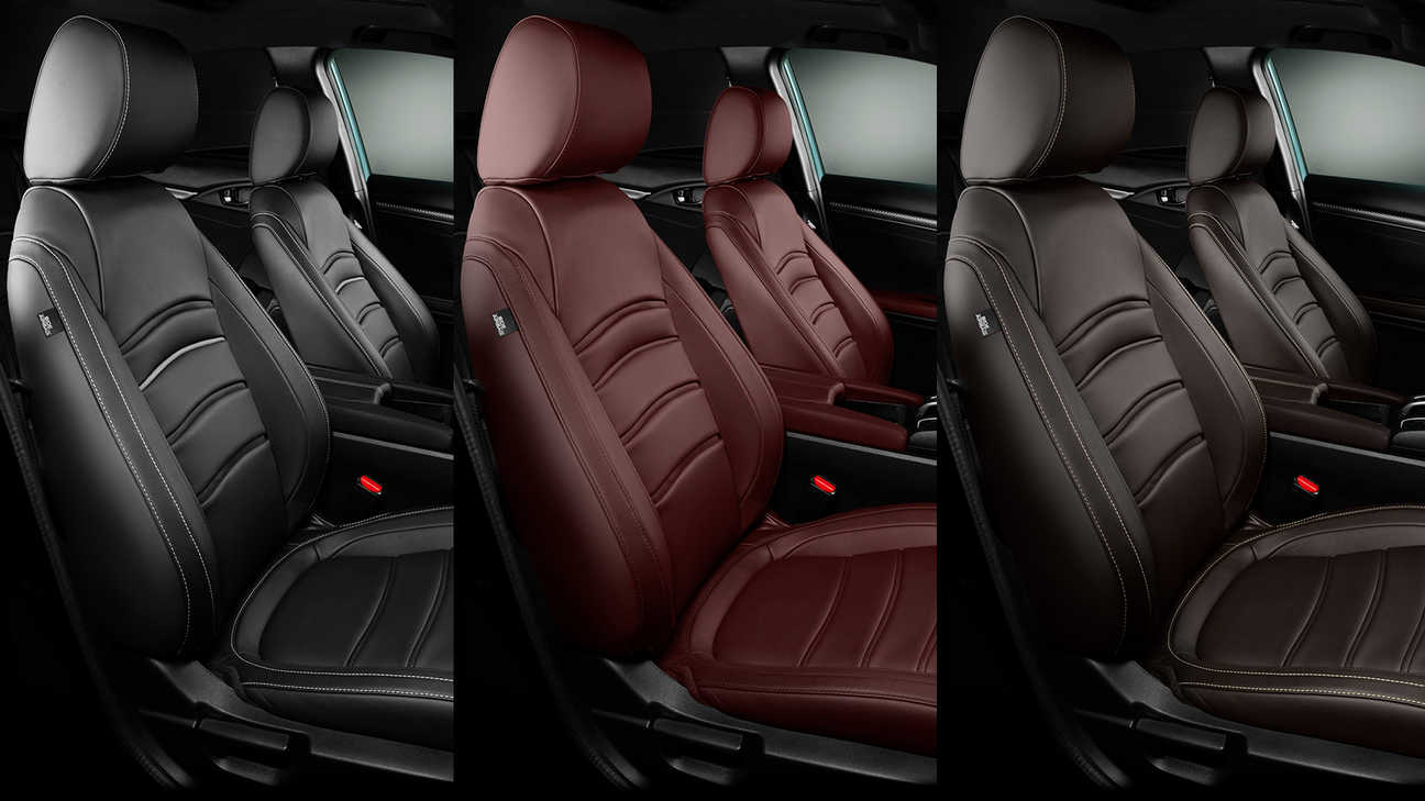 Close up of Honda Civic 5 door leather upholstery in Bordeaux Red, Midnight Black and Dark Brown.