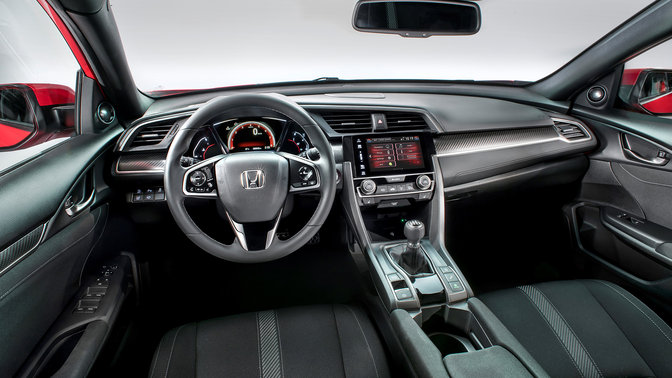 Driver's view of Honda Civic interior dashboard.