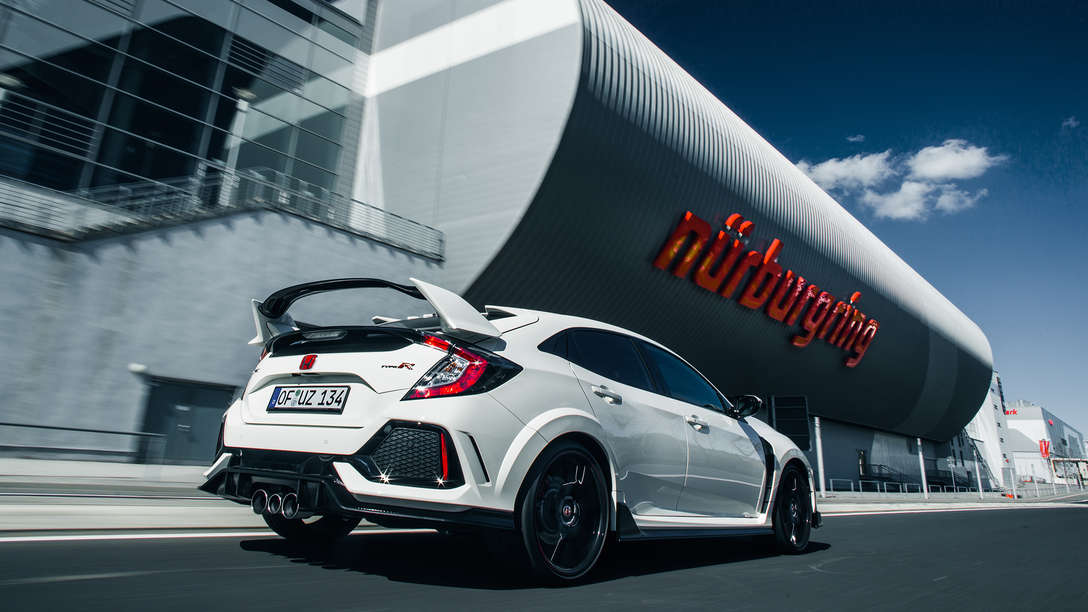 Rear three-quarter facing Honda Civic Type R outside Nürburgring.