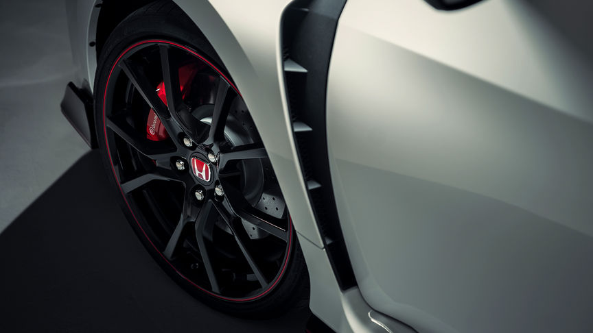 Front three-quarter facing Honda Civic Type R close up of alloys.