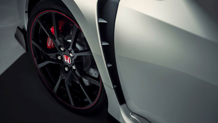 Close up of Honda Civic Type R wheel arches and air vents.