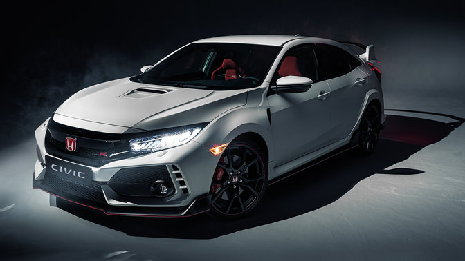 Front three-quarter facing Honda Civic Type R with headlights on.