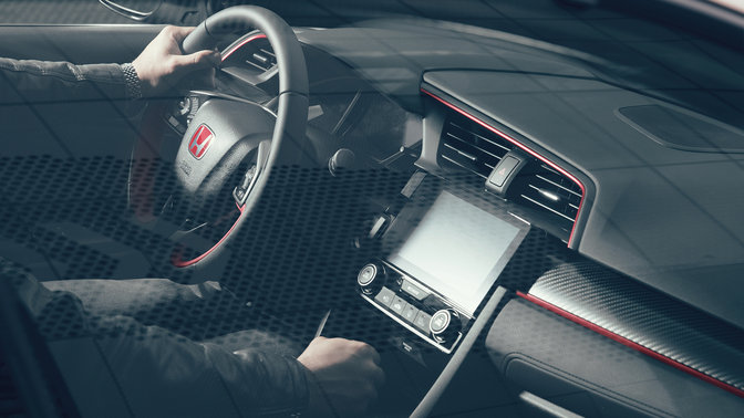 Three-quarter facing Honda Civic Type R dash and leather steering wheel.
