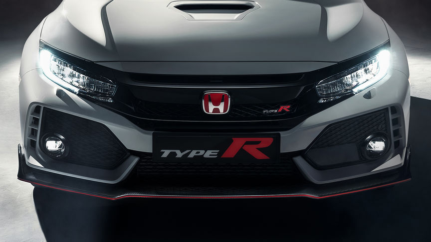 Close up of a front facing Honda Civic Type R to show front vents and bumper.