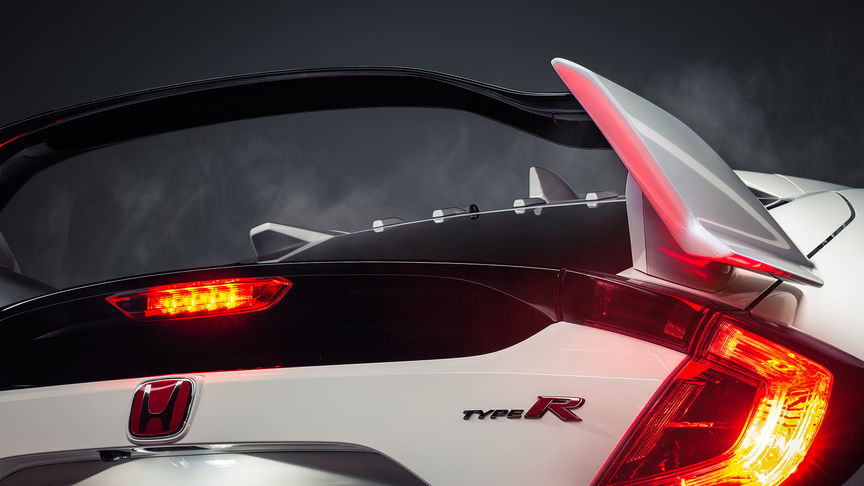 Close up of rear three-quarter facing Honda Civic Type R to show wing spoiler.