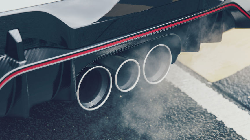 Close up of Honda Civic Type R Triple exhaust.