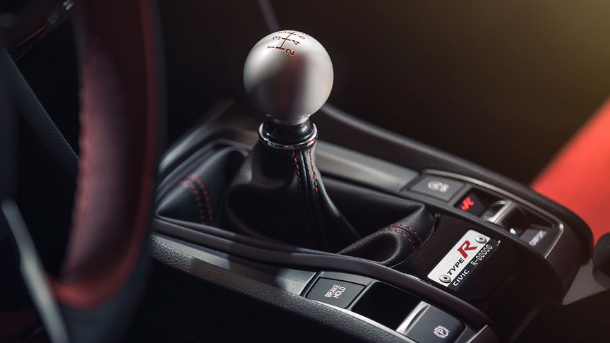 Close up of Honda Civic Type R alloy gear stick.