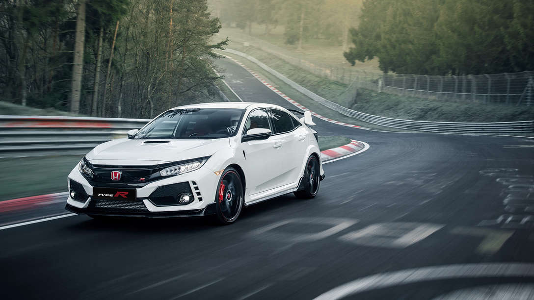 Front three-quarter facing Honda Civic Type R on race track.