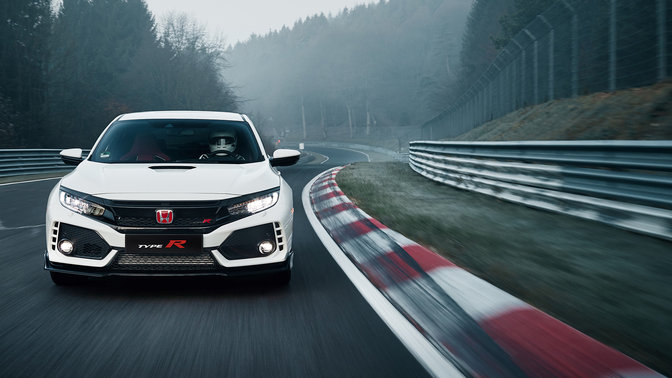 Front facing Honda Civic Type R on race track.