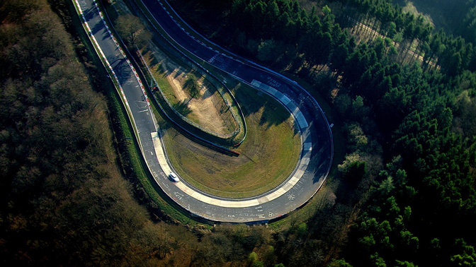 Birds-eye view of Honda Civic Type R on race track.