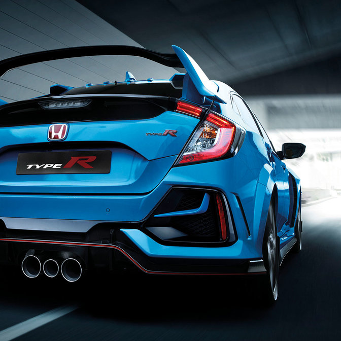 Rear three-quarter facing Honda Civic Type R outside.