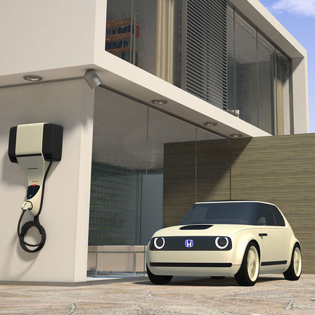 Front three-quarter facing Honda Urban EV Concept with charging point.