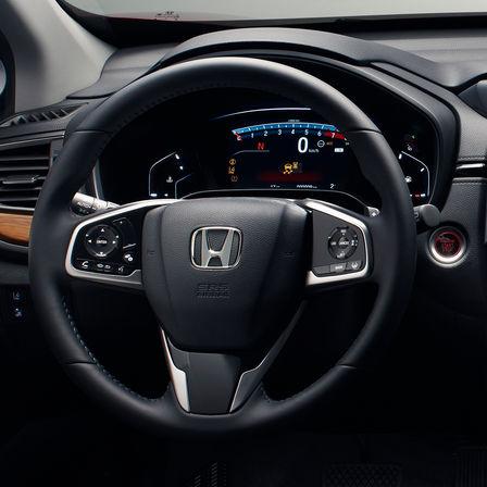 Close up shot of Honda CR-V steering wheel and dials.