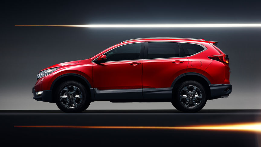Side facing Honda CR-V to show the sporty look and alloy wheels.
