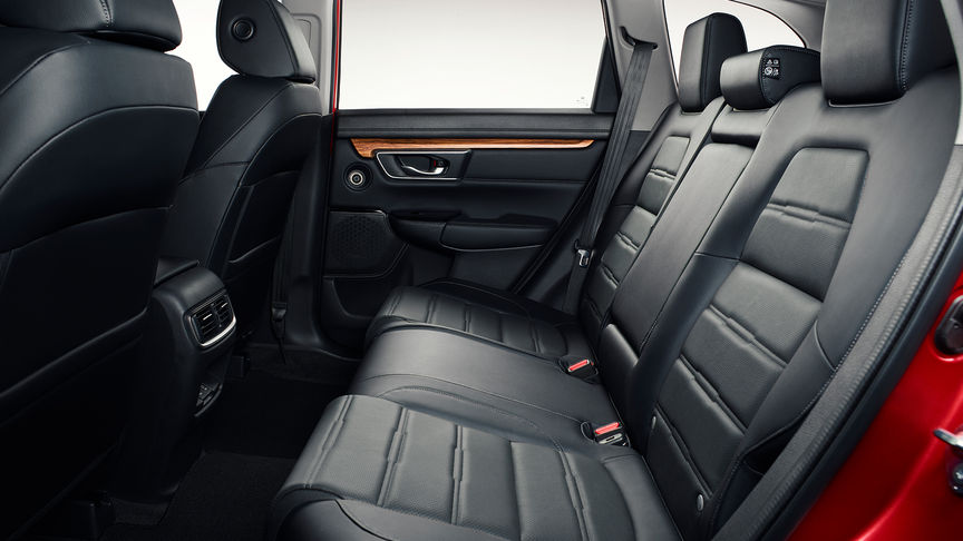 Side facing shot of the Honda CR-V interior to improved space.