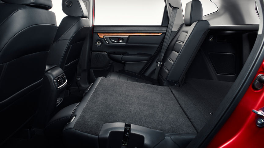 Side facing shot of the Honda CR-V interior with the rear seats folded down.