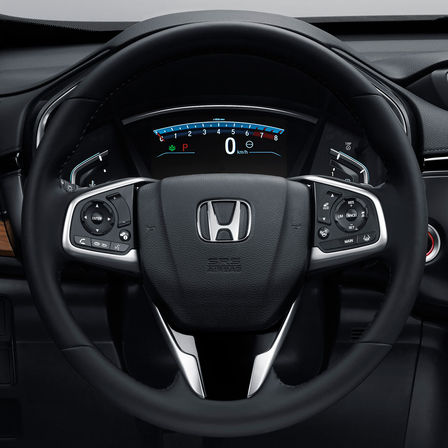 Close up of Honda CR-V multi-functioning steering wheel.