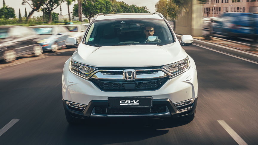 Front facing view of Honda CR-V Hybrid car in street location.