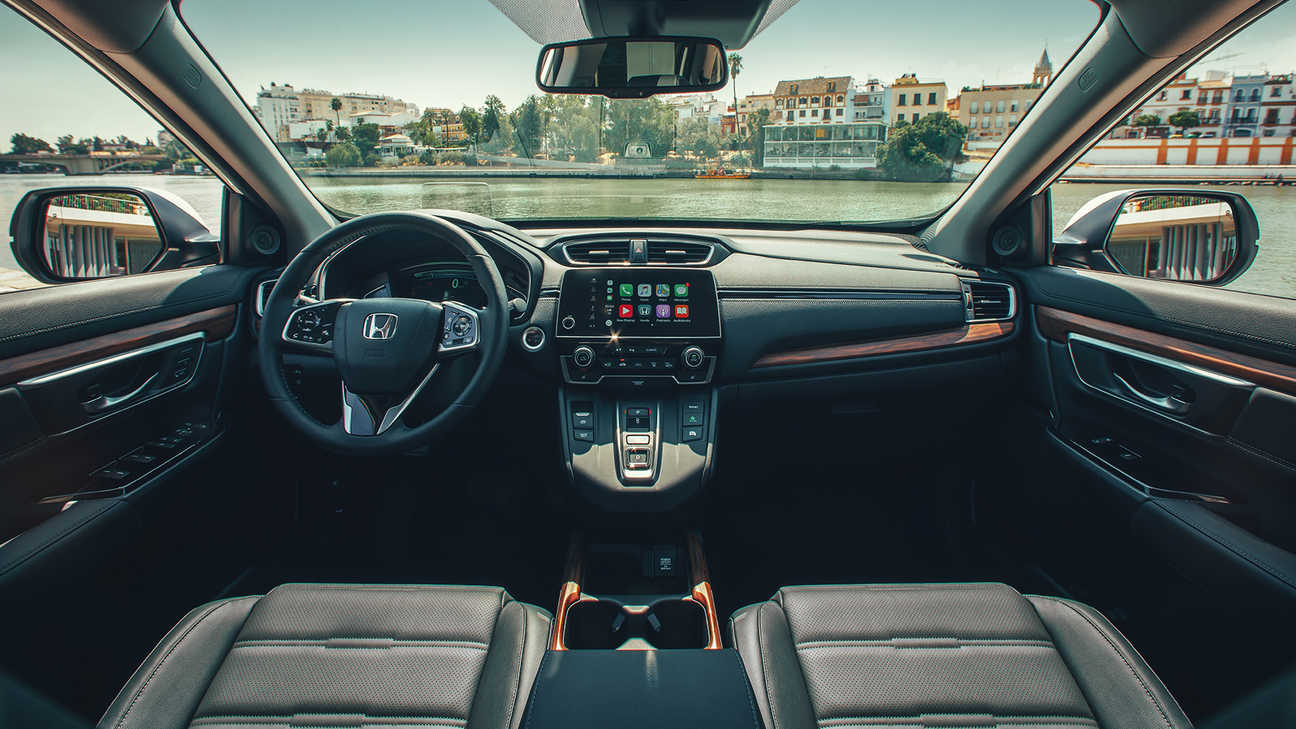Interior dashboard of Honda CR-V Hybrid illustrating wide view feature in a street location.