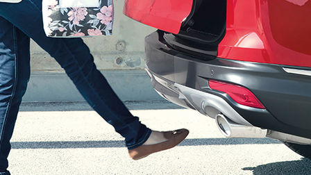 Side view Honda CR-V Hybrid hands free boot technology.