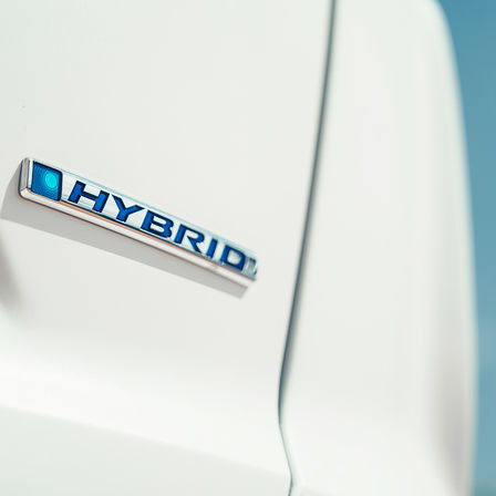 Close up shot of Honda CR-V Hybrid logo.