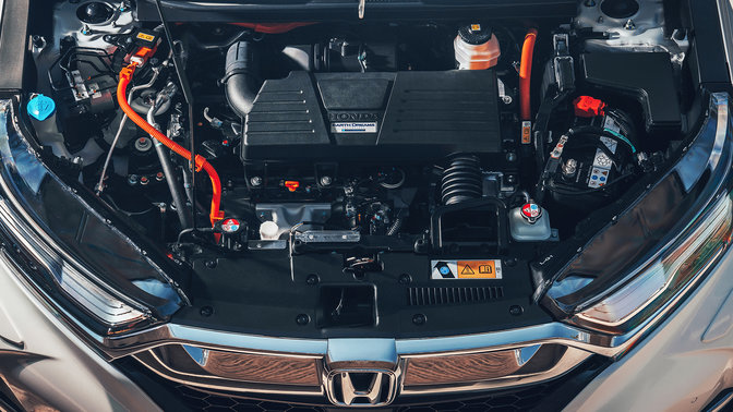 Front facing close up or Honda CR-V Hybrid Atkinson Cycle petrol engine.