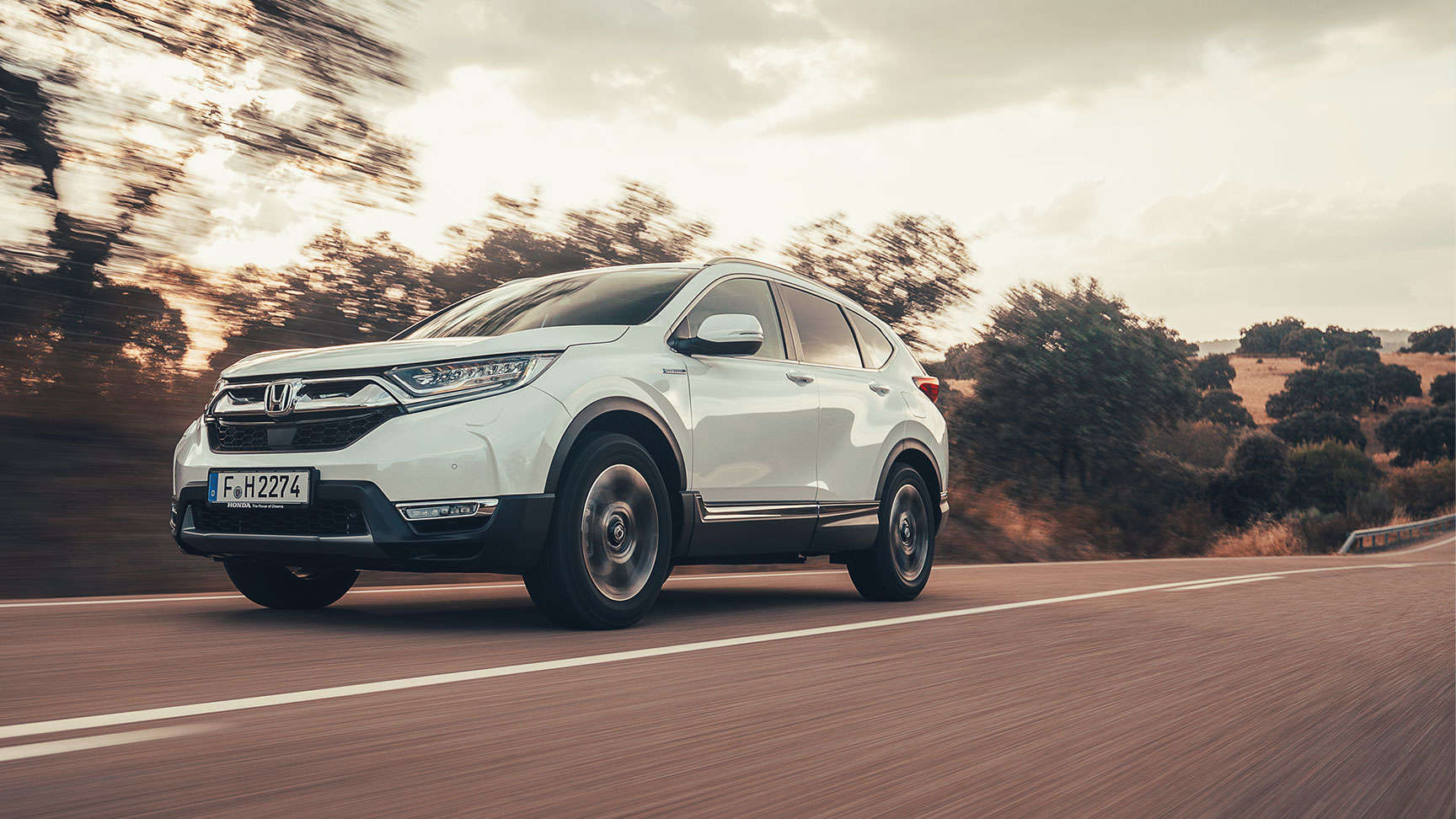 Front facing three quarter Honda CR-V Hybrid on road