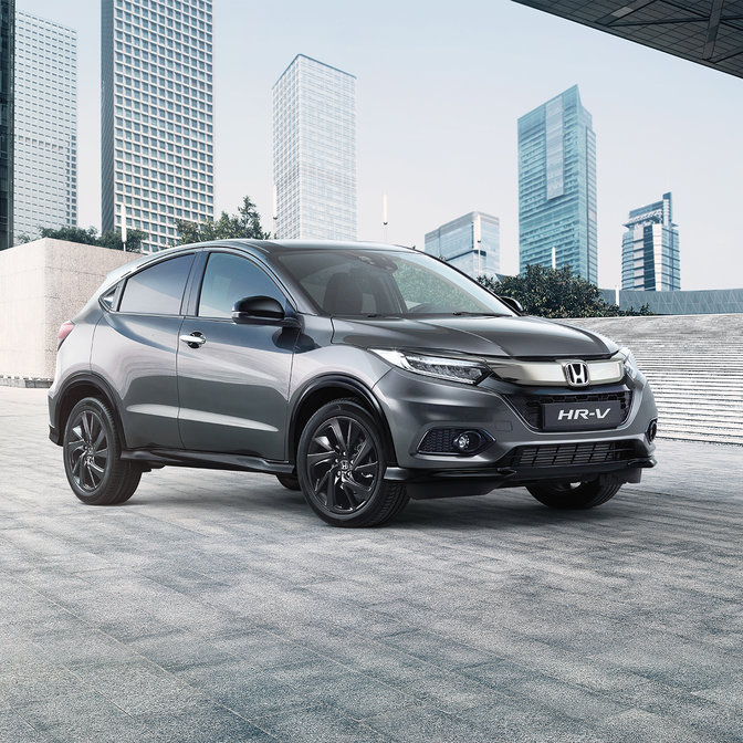 Side facing Honda HR-V Sport in urban location.