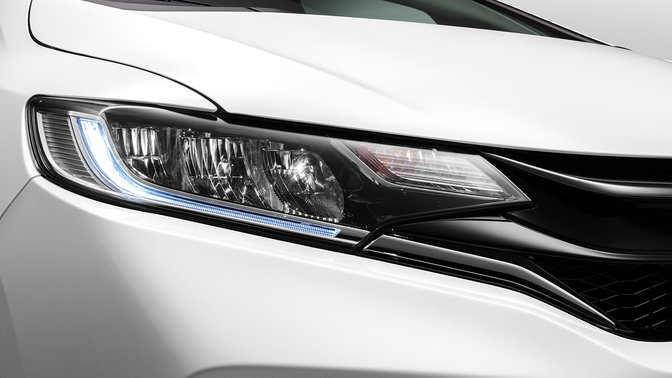 Close up of headlights on Honda Jazz Sport.
