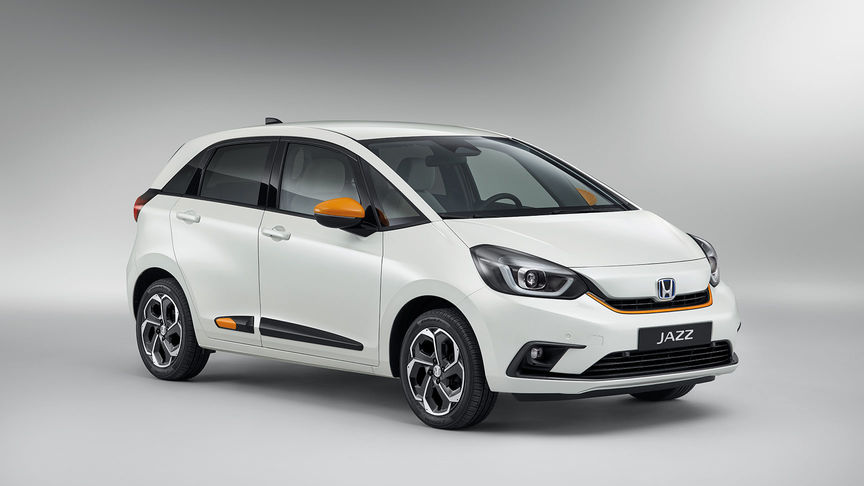 Taffta White Honda Jazz Hybrid in Studio with Functional Fun Pack Orange/White