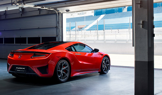 NSX driving out of garage