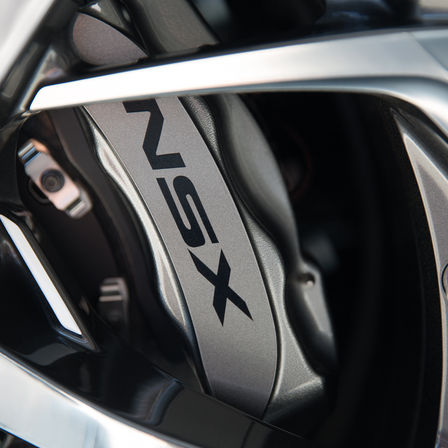 Close up of Honda NSX carbon ceramic disc.