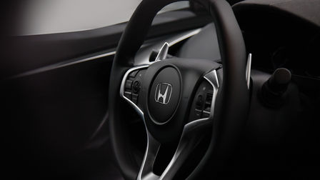 Close up of Honda NSX steering wheel.
