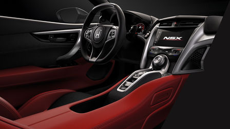 Three-quarter facing shot of Honda NSX red interior dash.