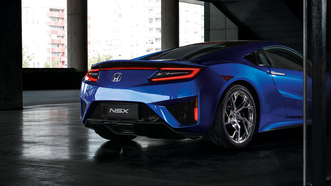 Rear three-quarter facing Honda NSX.