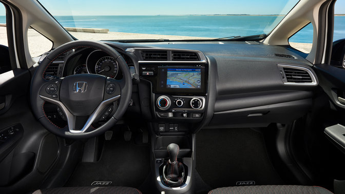 Image of Honda car interior overlooking the beach.