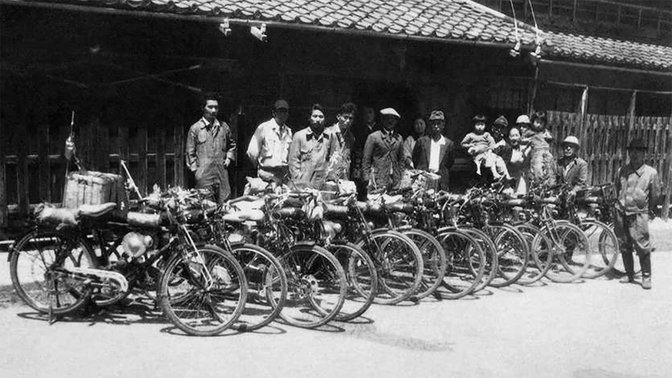 Some of the original Honda employees outside the Hamamatsu factory in 1948.