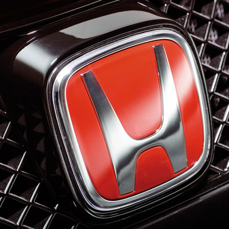 Close up of the Honda red 'H' logo.