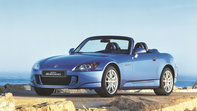 Front three-quarter facing Honda S2000.