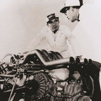 Soichiro Honda working on a racing car.