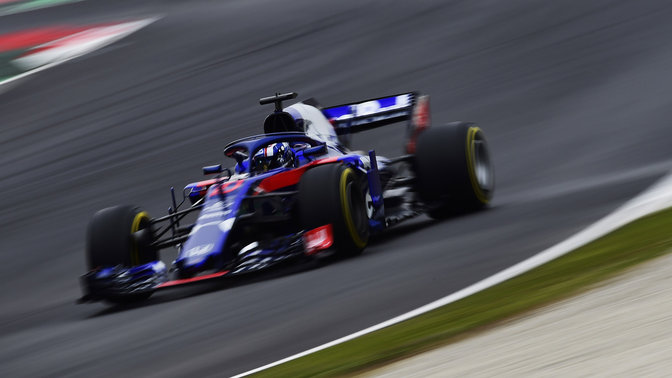 Front three-quarter facing Toro Rosso Honda on the race track.