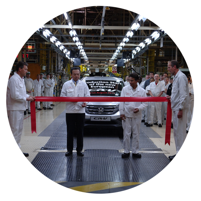 Front facing Honda CR-V with factory workers.