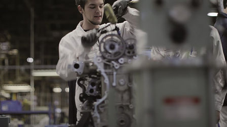 Honda technician working on an engine.