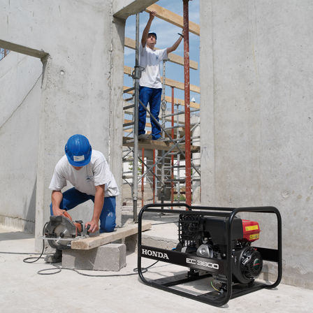 professional open frame endurance generator being used by a worker on building site