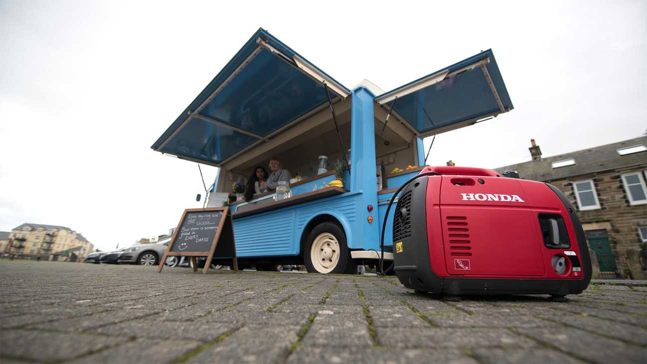 close up of portable inverter generator being used to power food truck