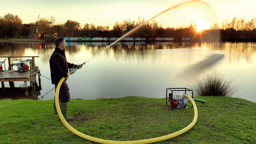 High pressure water pump, being used by model, lake location.