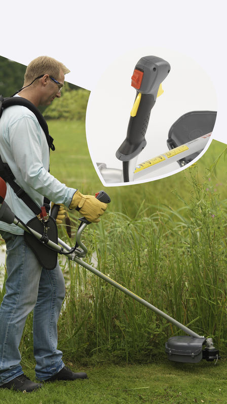 Brushcutter being used by model, focusing on adjustable handles, garden location.